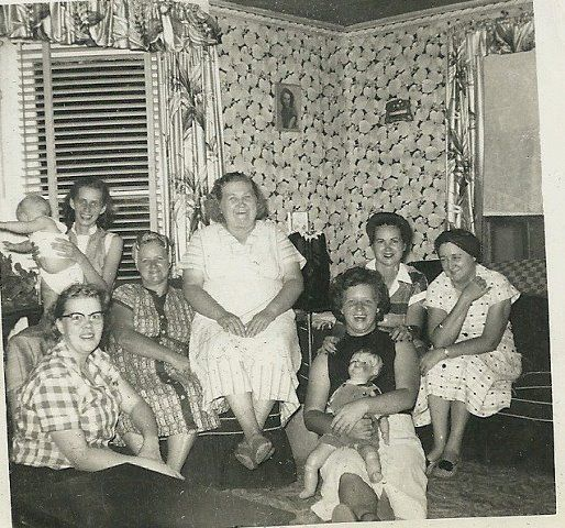 Grandma Burger (Hattie) with Becky (baby), Betty Jo, Goldie, and Virginia (holding the doll). Maybe someone can help with the other three ladies.