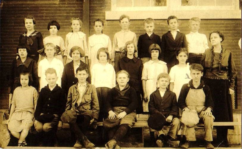 Dad's school photo Gordon Clair Mansker first on the right in the front roll right in front of the TeacherDon't know the names of any of the others.